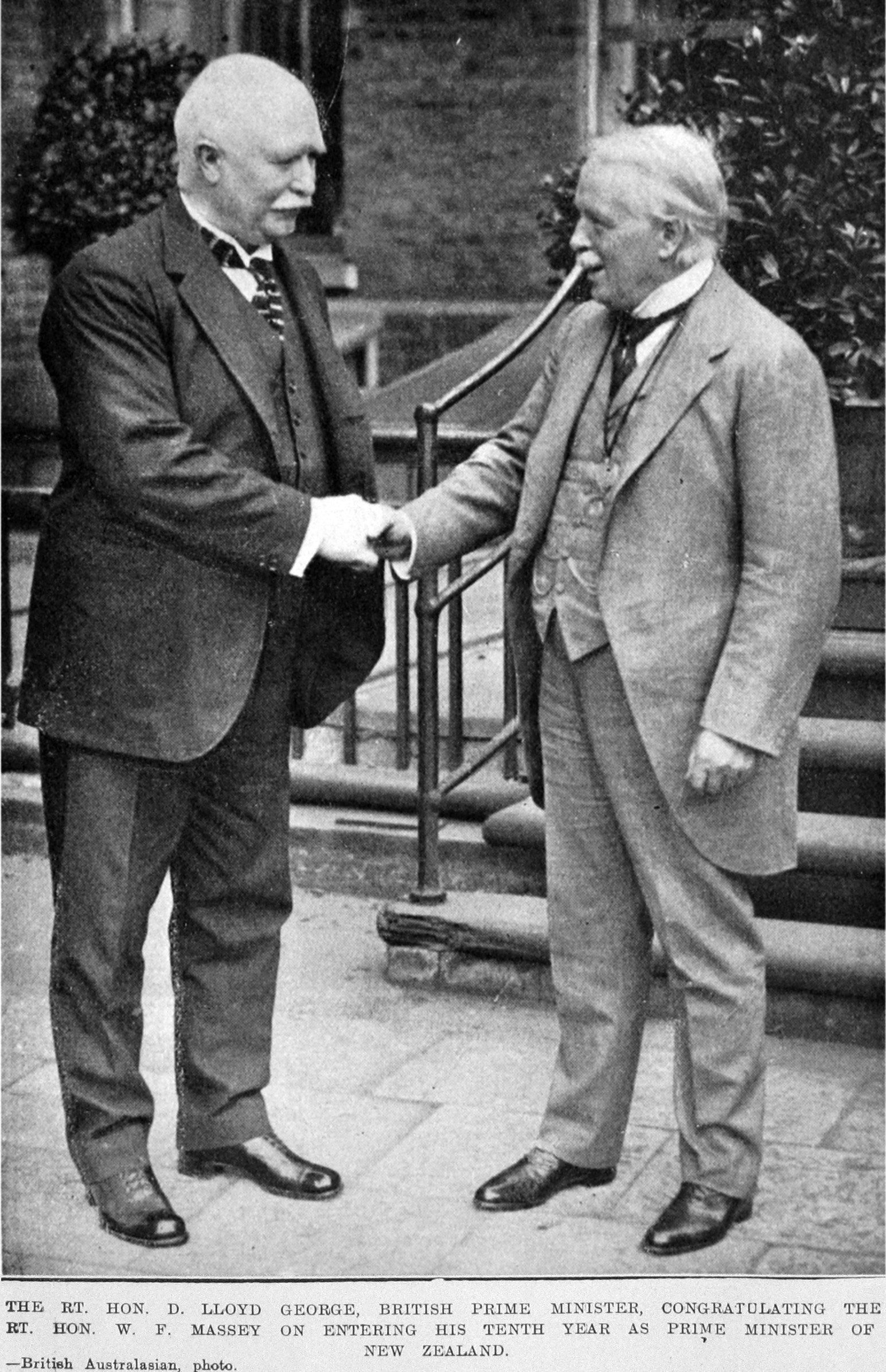 British Prime Minister Rt Hon David Lloyd George (right) congratulates Rt Hon William Massey. —...