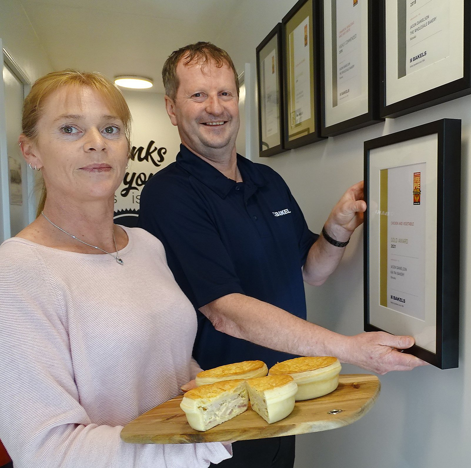 Kai Pai Bakery dispatch manager Julie Danielson and head baker Jason Danielson with his prize...