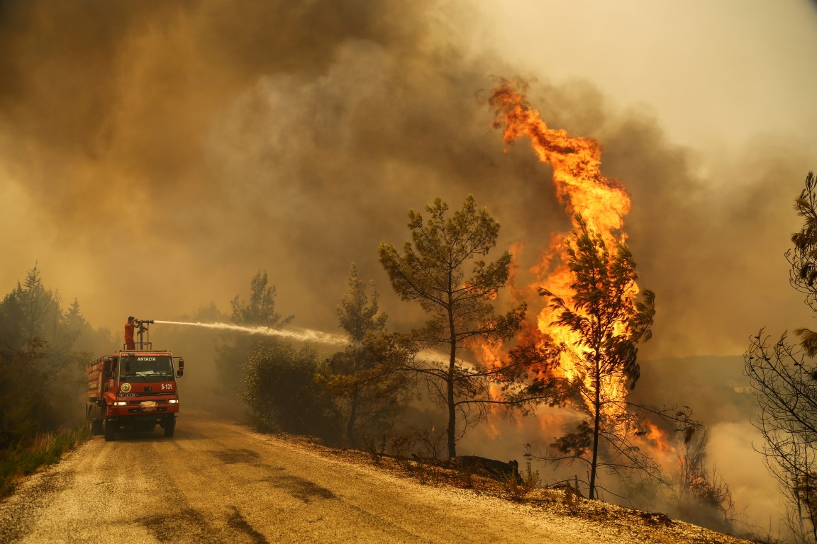 A crew battles a forest fire near the town of Manavgat, east of the resort city of Antalya. Photo...