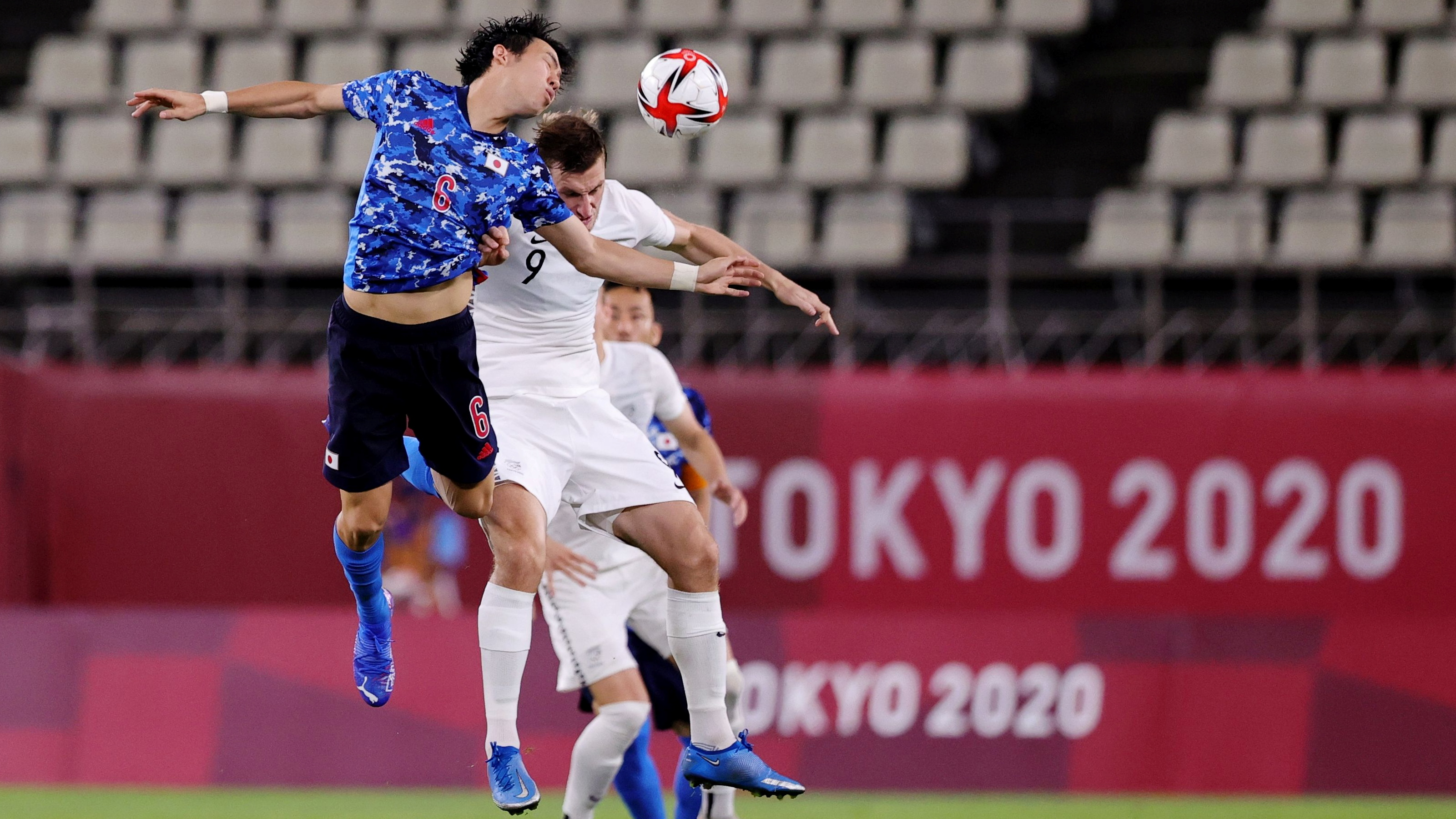 Japan's Wataru Endo and  Olywhite Chris Wood compete for the ball. Photo: Reuters