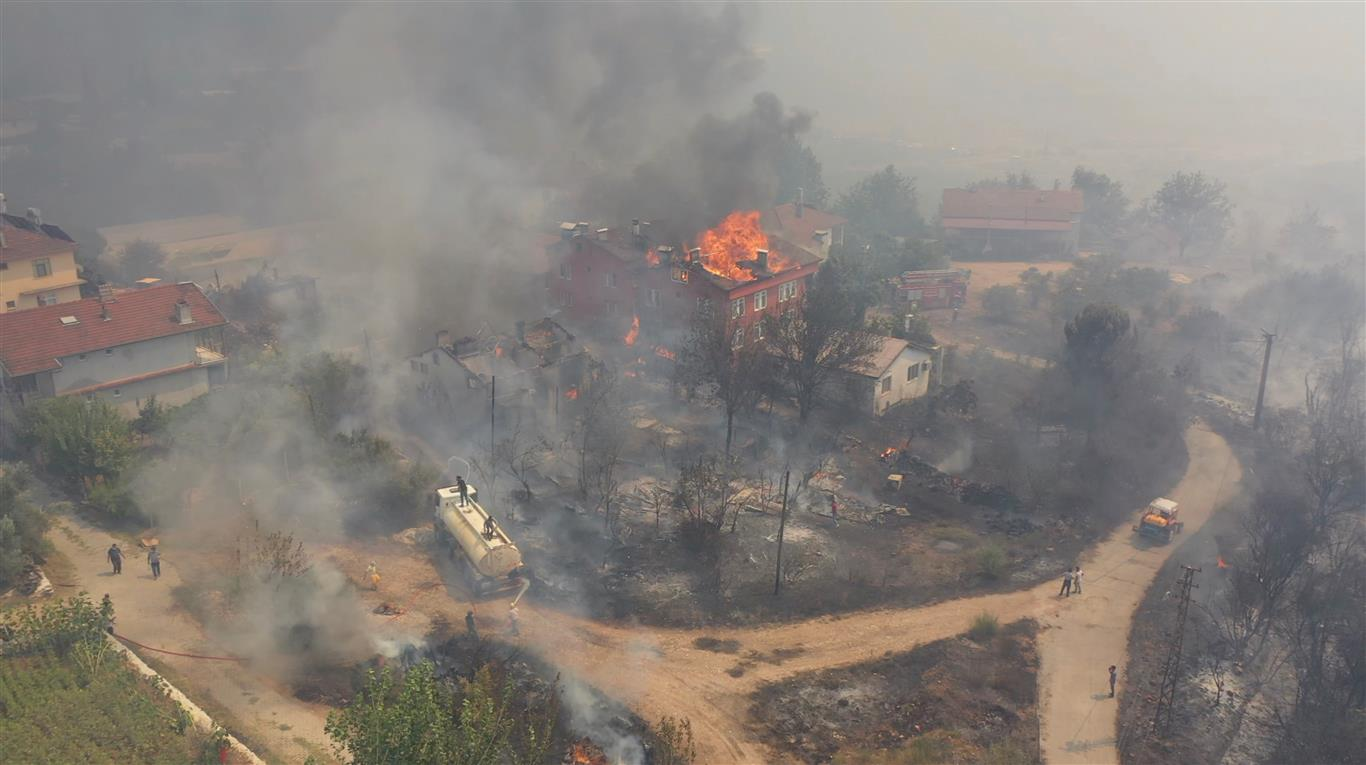 Buildings burn as people try to contain a fire in Melikler, Isparta Province, Turkey. Photo:...