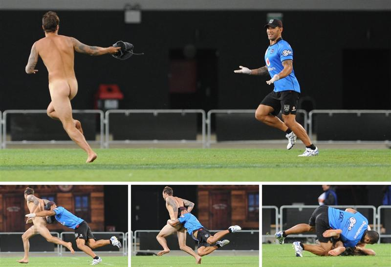 A streaker is tackled by former Kiwis player Ruben Wiki during a Warriors-Broncos preseason match...
