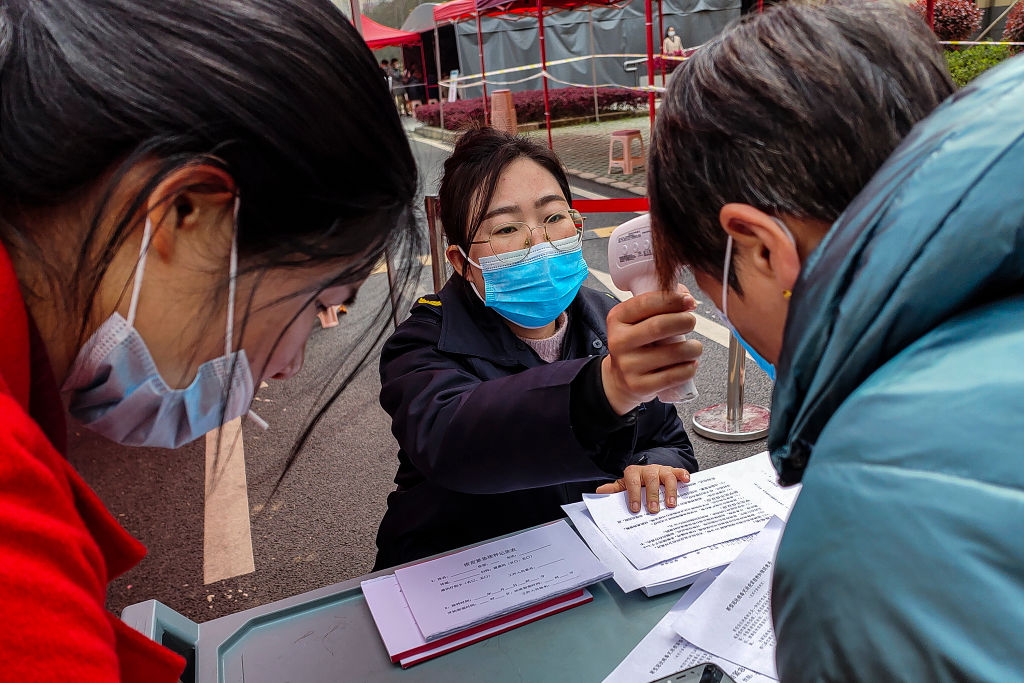 Temperatures are taken at a Covid testing station in Wuhan earlier this year. Photo: Getty