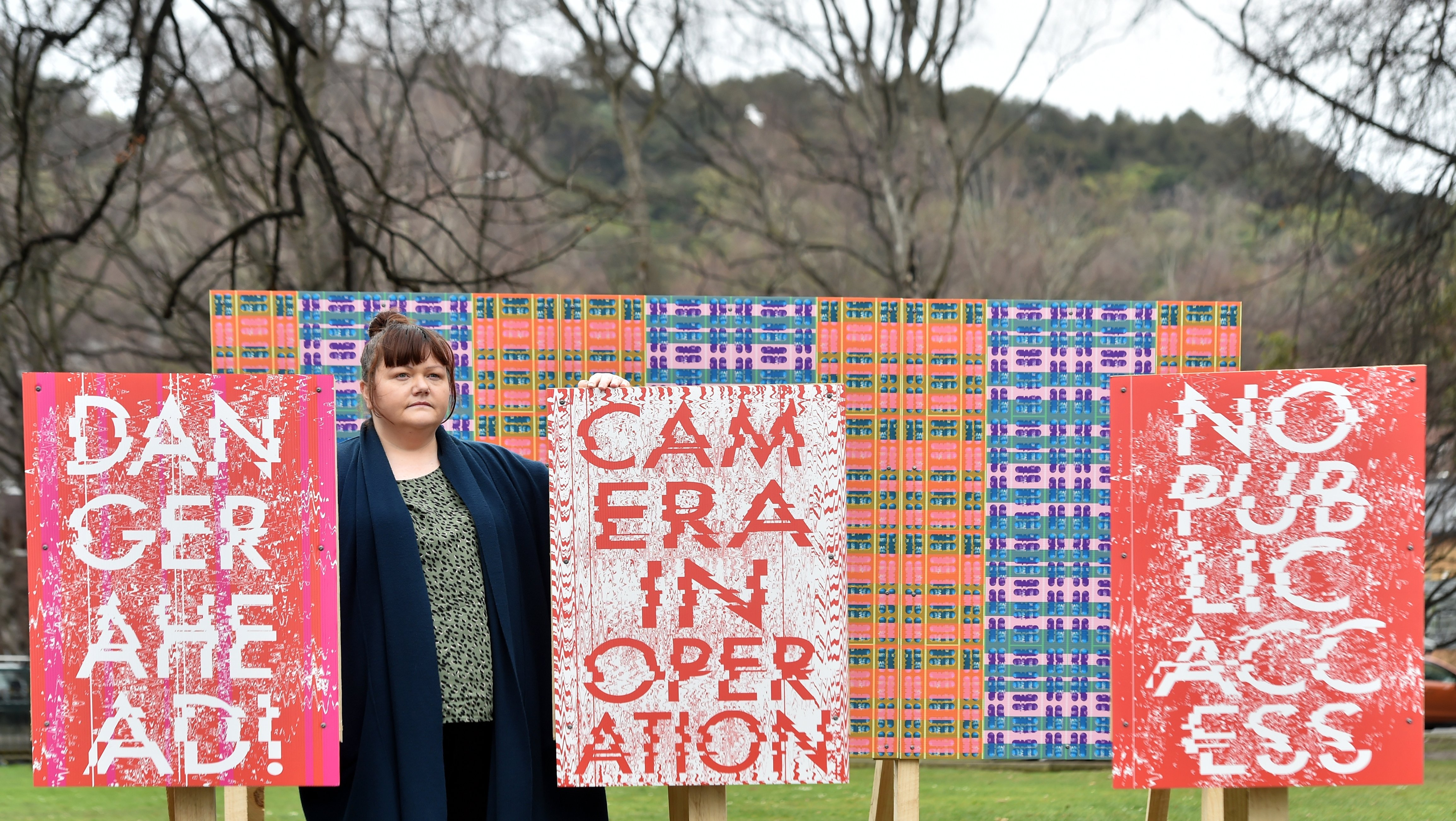 Artist Maggie Covell with her Billboard Wallpaper at the Otago Museum Reserve. PHOTO: PETER MCINTOSH