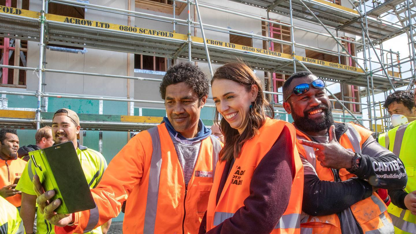 Prime Minister Jacinda Ardern posing for selfies in 2020 with tradesmen at Isles Construction in...