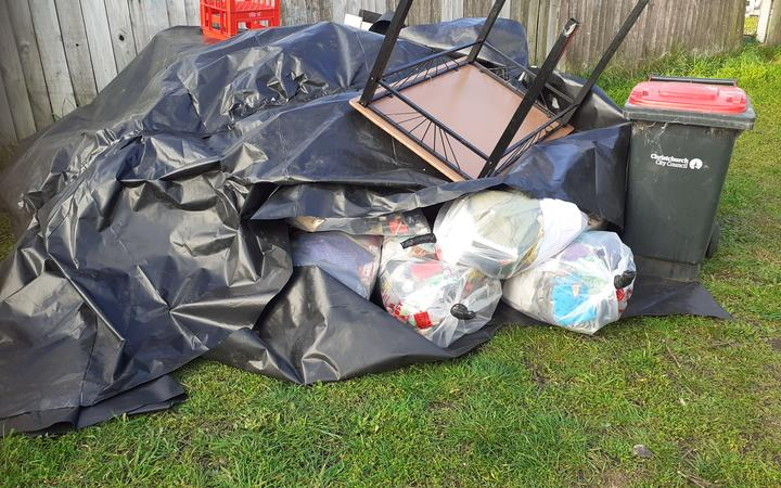 Some of the family's possessions dumped in their front yard. Photo: Supplied