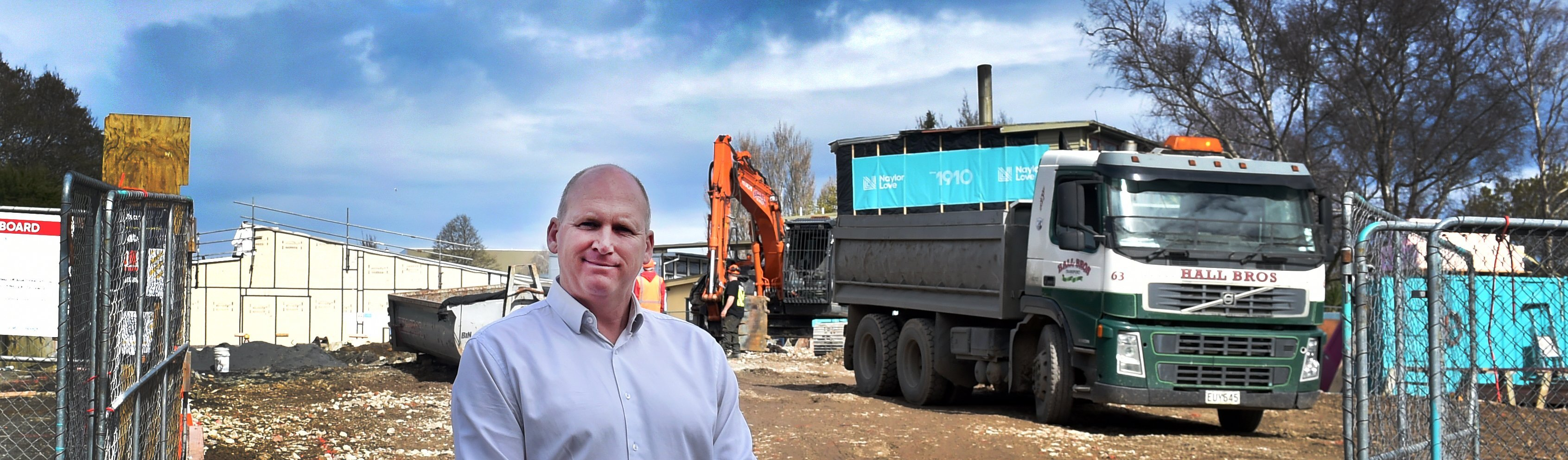 Kaikorai Primary School principal Simon Clarke stands in front of a block of classrooms which...