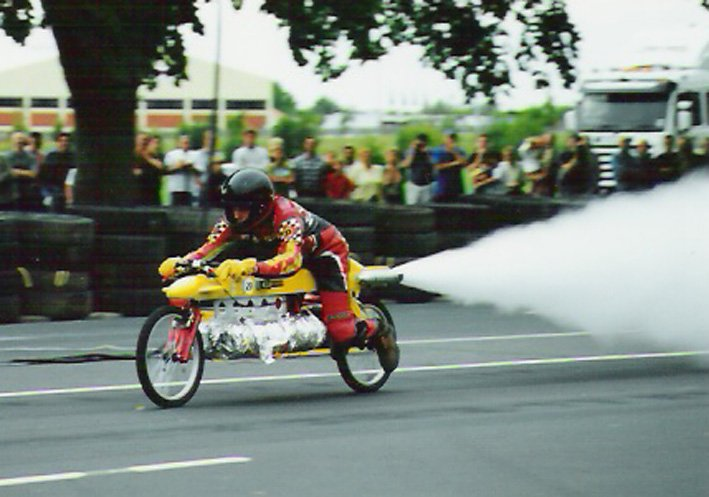 Mr Beck demonstrates his steam-powered bike in Dunedin's Princes St, at the Festival of Speed,...
