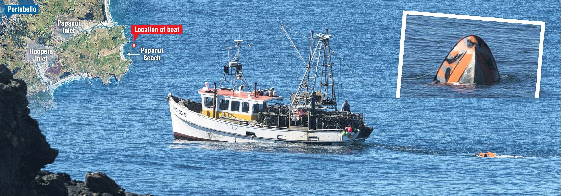 Commercial fishing boat Echo tows the submerged recreational boat back to Carey's Bay after it sank near Papanui Beach, on Otago Peninsula. Inset: The bow of the sinking boat points skyward off the Dunedin coastline yesterday. Two minutes later, it was fu