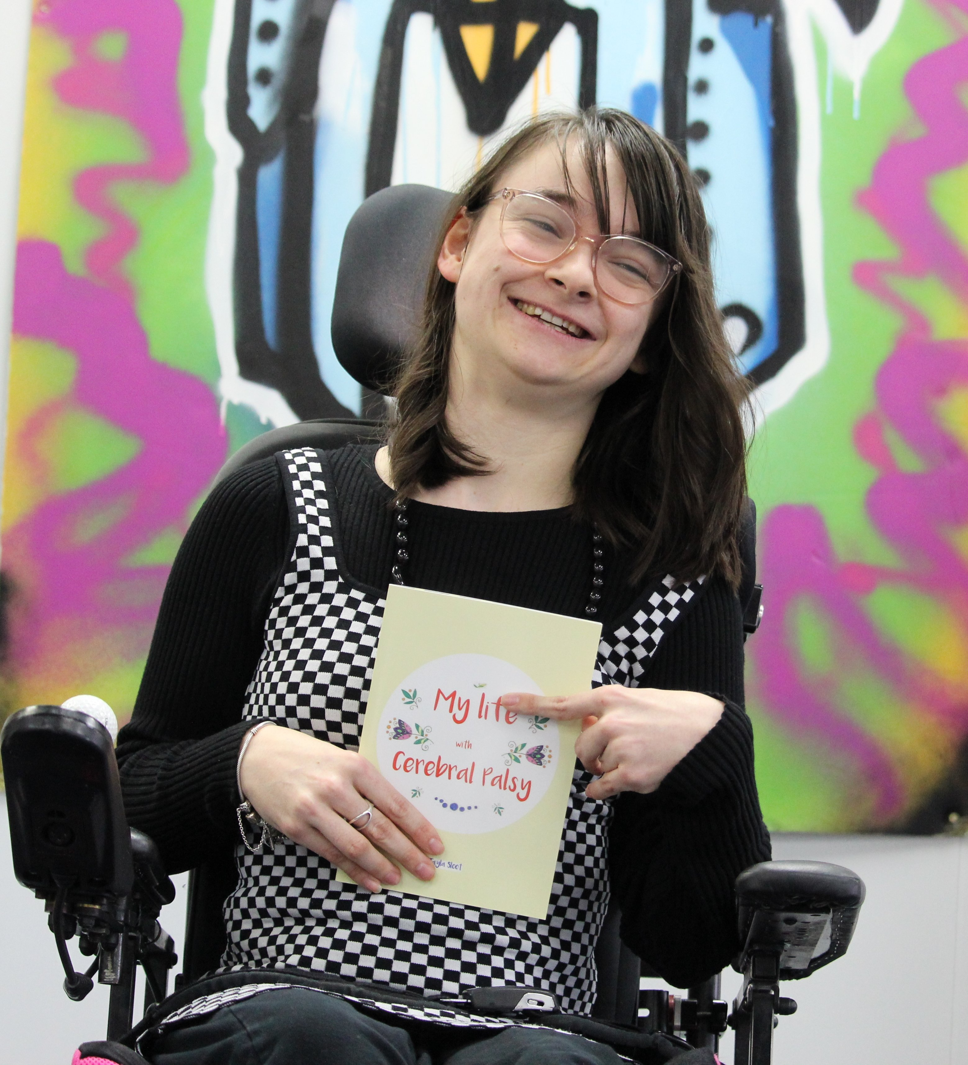 Tayla Sloot with her new book My Life with Cerebral Palsy which helps children understand her...