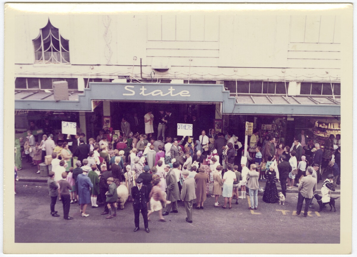 Movie-goers queue for a ticket outside the State Cinema in Colombo St. If you have historic...