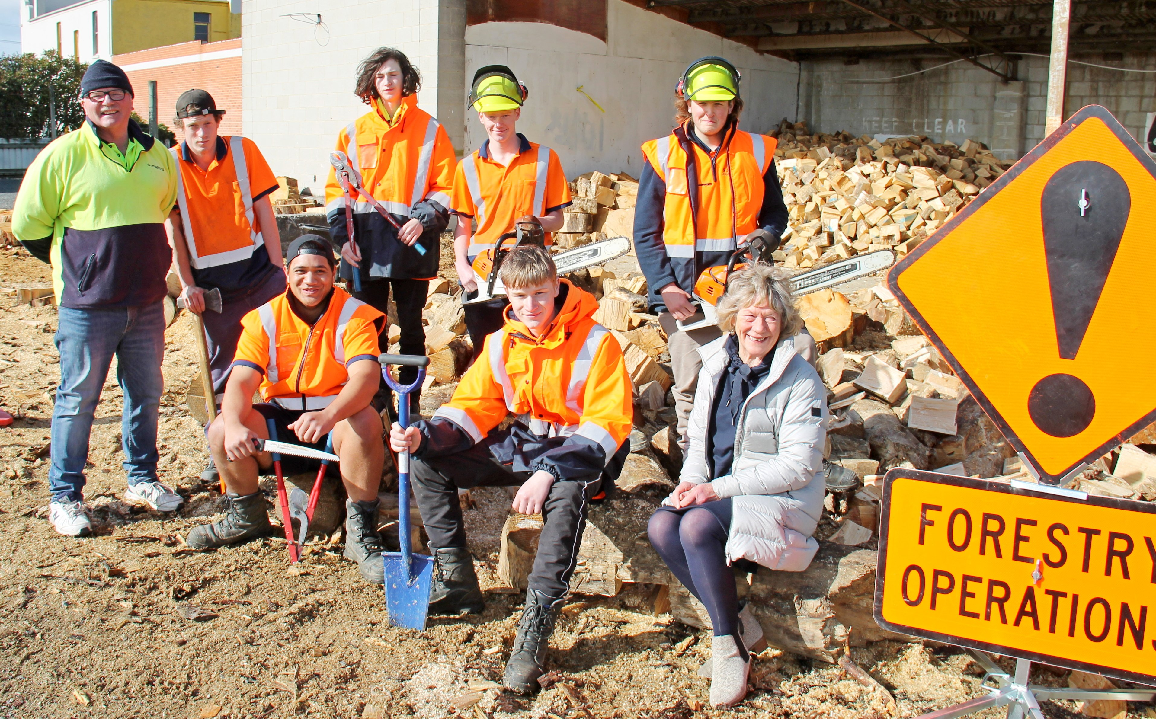 Hoping the Governmentwill continue to support them are Tokomairiro Training Forestry Pathways personnel (from left) tutor Alistair McKenzie, Connor Brown, Taine Parker (seated), Luke Hewison, Harvey Pringle, Michael Bennett (seated), Anthony Smart and pro