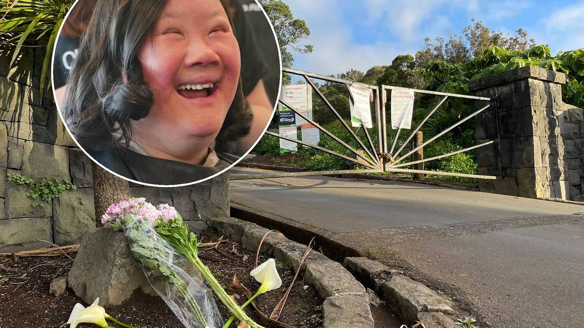 Flowers lie at the top of the bush-lined walkway where Lena Zhang Harrap's body was found on...