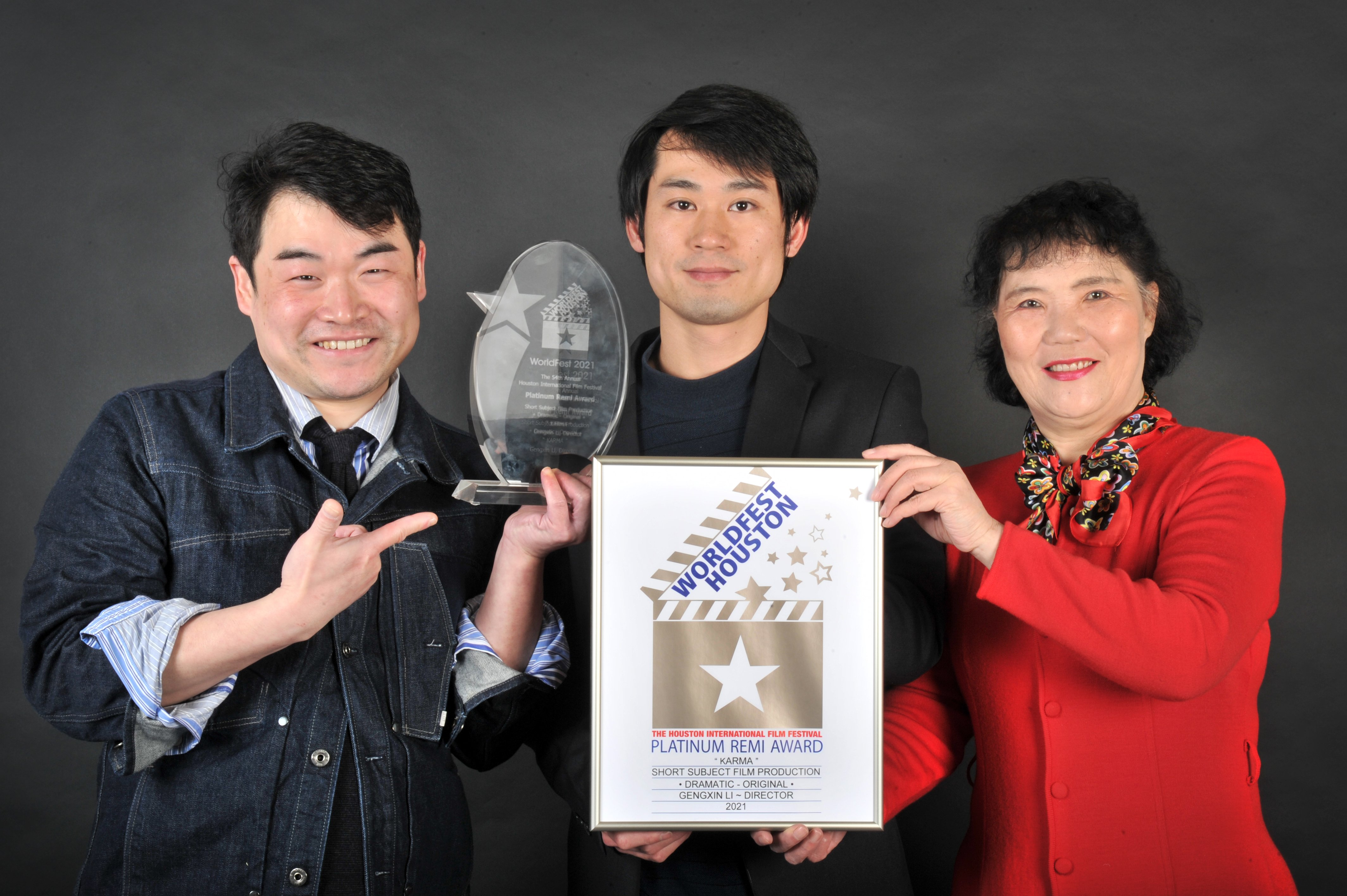 Dunedin-based director Sam Li (left), with producer Dingwei Lin and actor Weidi Xu, celebrate the...