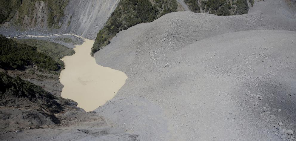 A massive slip on Mt Manukau in the Seaward Kaikoura Range has blocked a section of the Hapuku Stream and covered Barratts Hut. Photo: NZ Herald