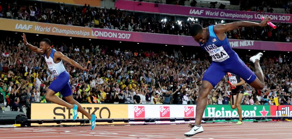 Nethaneel Mitchell-Blake of Great Britain (left) wins the race ahead of Christian Coleman of the...