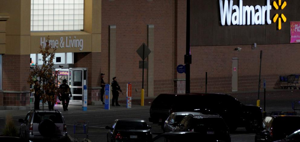 Police guard the entrance to the store in Thornton. Photo: Reuters