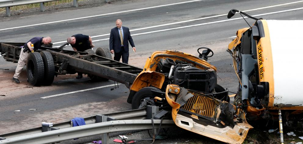 The front of the bus was ripped off in the crash. Photo: Reuters