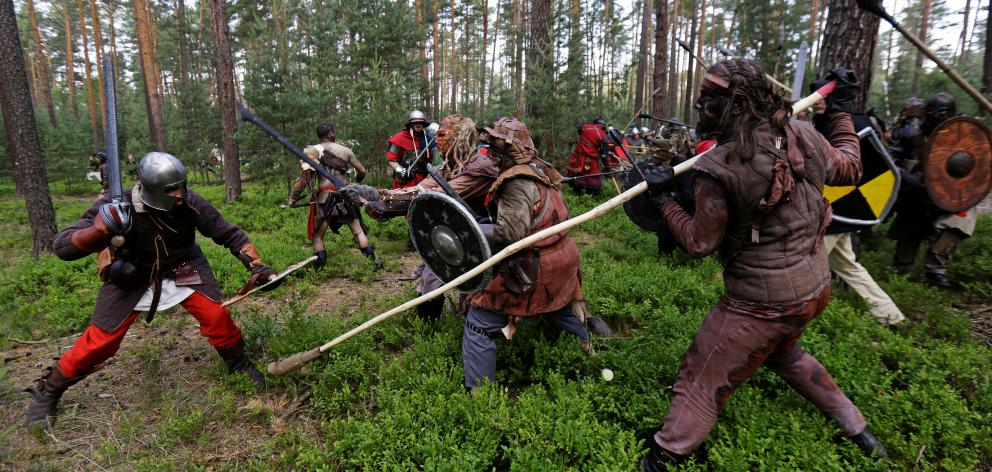 Participants in the Tolkien-themed battle in a forest near the town of Doksy, Czech Republic....