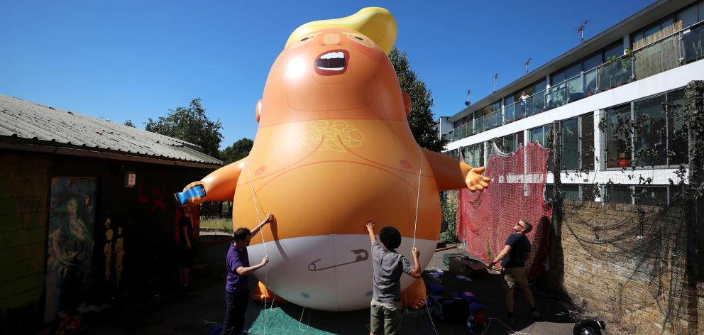 A large balloon floated near parliament portraying Donald Trump as an orange, snarling baby. Photo: Reuters