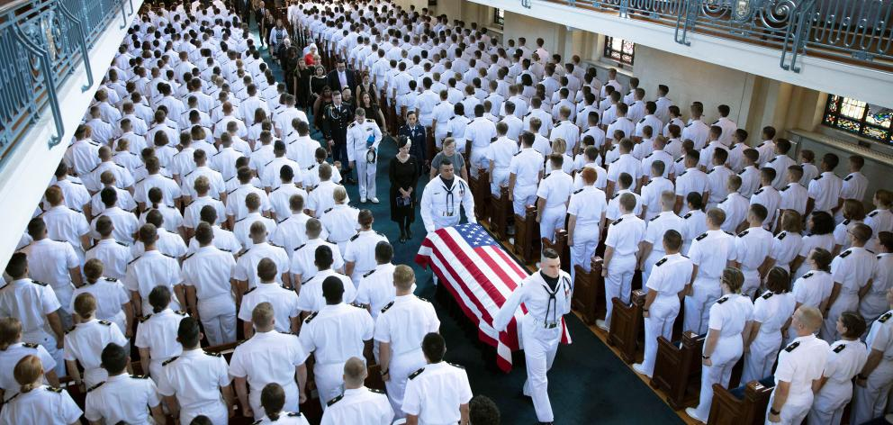 The family follows as the casket of Senator John McCain from the Chapel on the grounds of the US...