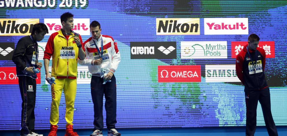 Bronze medallist Duncan Scott distanced himself from Sun Yang by not standing on the podium....