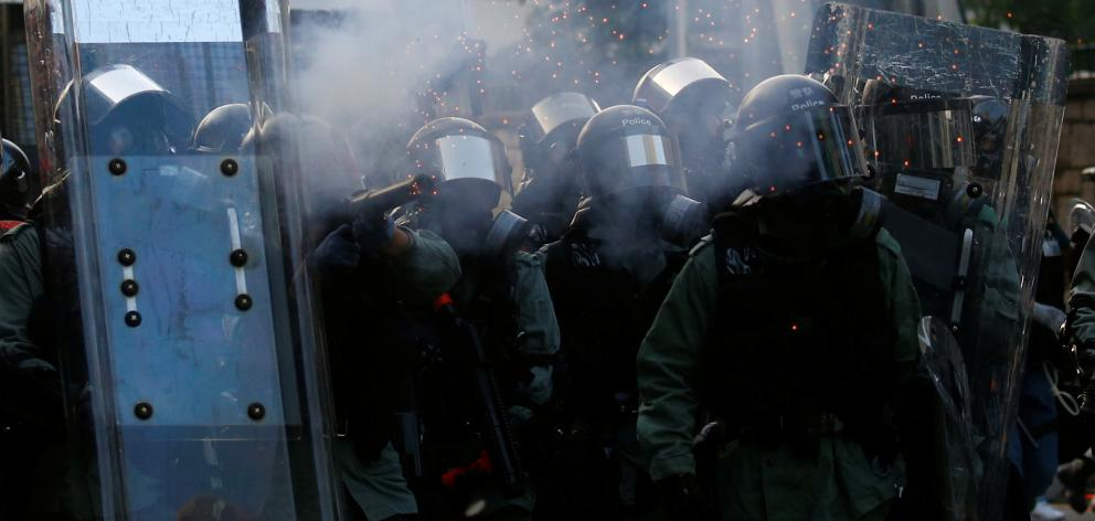 Riot police have used tear gas against increasingly violent protests. Photo: Reuters