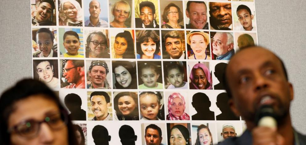 Pictures of victims of the Grenfell Tower fire are seen during a news conference attended by...