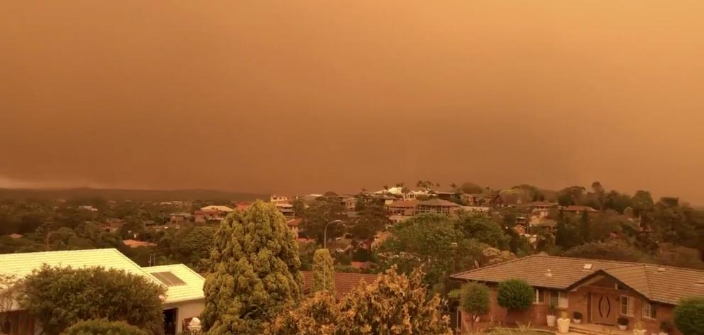 Smoke with an orange tint has been blanketing the sky in New South Wales. Photo: Laura Begbie via...