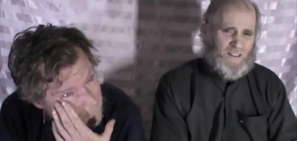 Timothy Weeks (left) and Kevin King speak to the camera while kept hostage by Taliban insurgents....