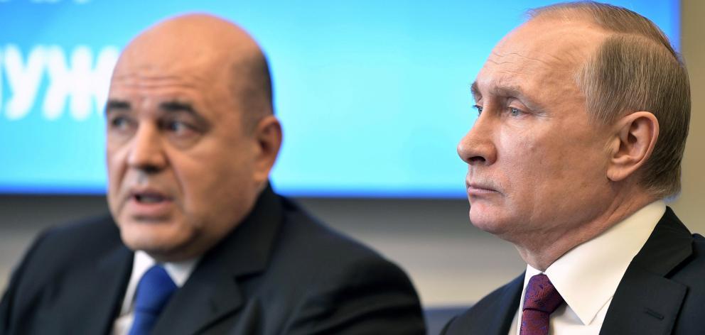 Vladimir Putin (right) with Mikhail Mishustin. Photo: Sputnik/Kremlin via Reuters
