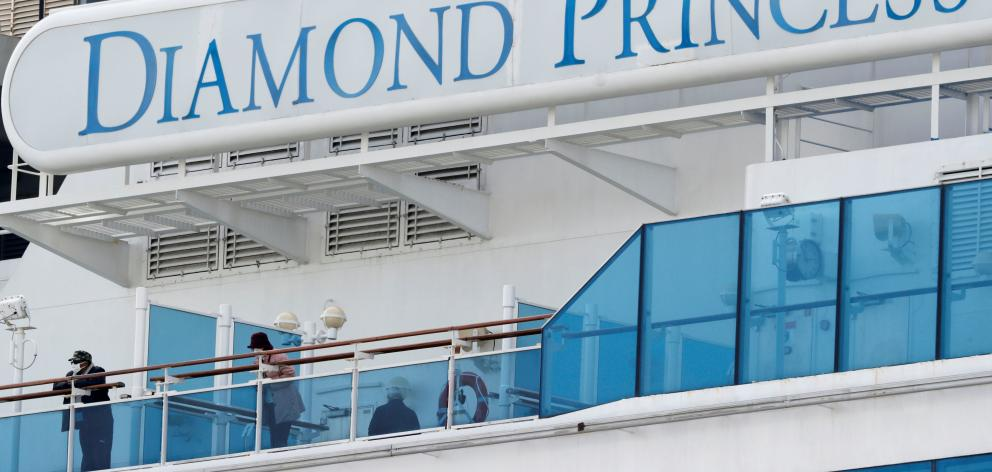 The Diamond Princess was placed in quarantine for two weeks upon arriving in Yokohama, south of...