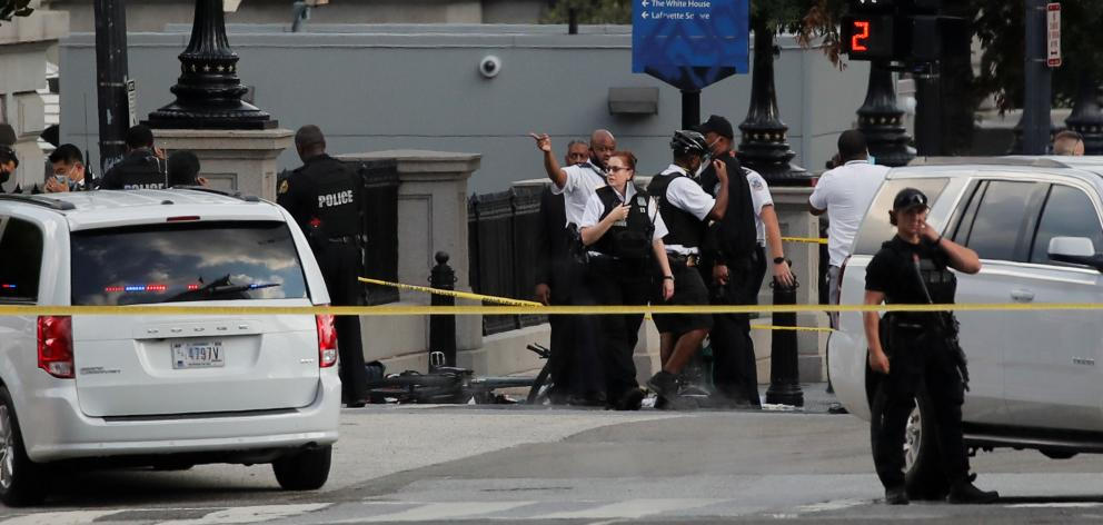 Police stand guard at the corner of 17th Street and Pennsylvania Avenue, after a shooting...