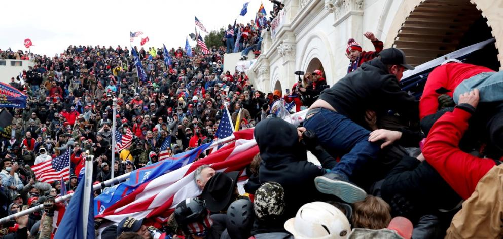 Rioters stormed the Capitol on January 6, sending lawmakers into hiding and leaving five people...