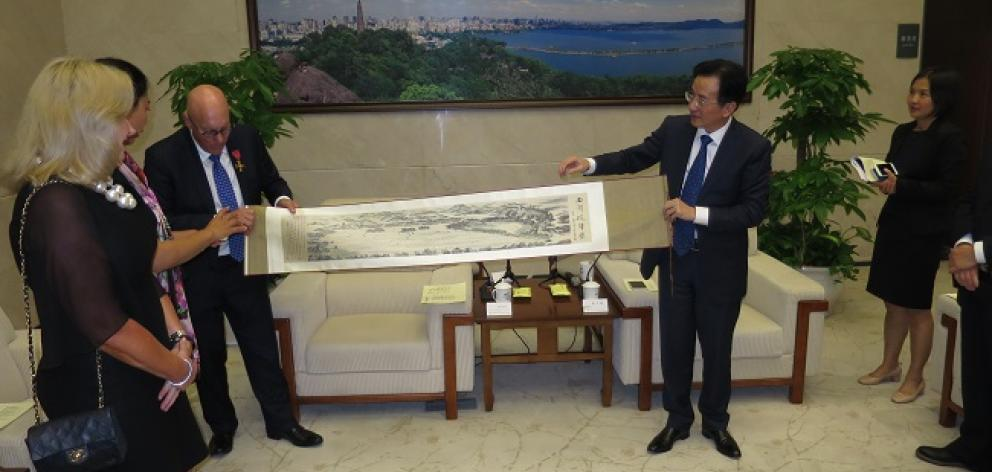 Mayor Jim Boult accepts a gift from Hangzhou vice mayor Chen Weiqiang on behalf of Queenstown. Photo: Mountain Scene