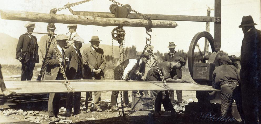 Southland Power Board members watch pipes being rolled, circa 1924.