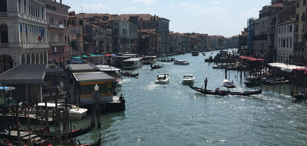 Boats glide down Venice's Grand Canal.