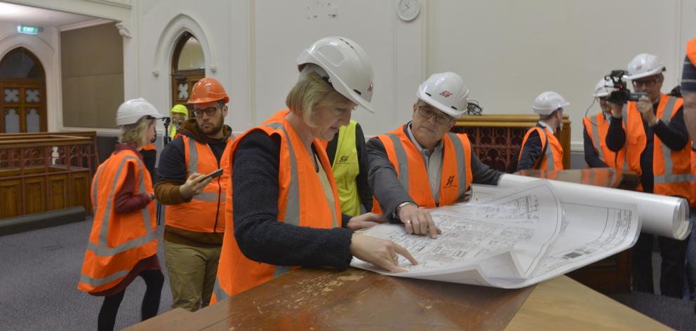 Amy Adams and Richard Johnston of Amalgamated Builders review plans in the Dunedin District Court...