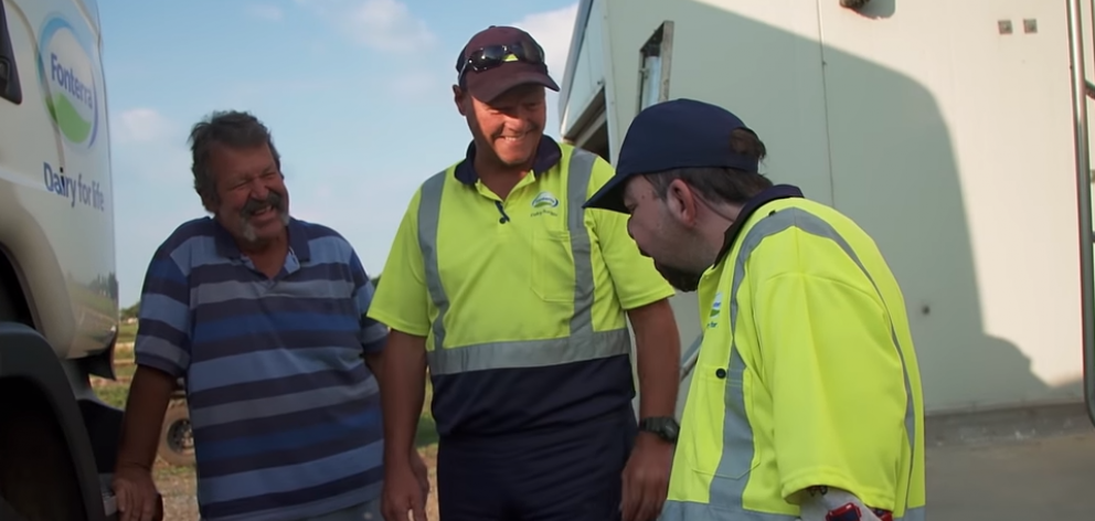 Andrew greets a Fonterra driver (centre) with dad Kevin. Image: RNZ