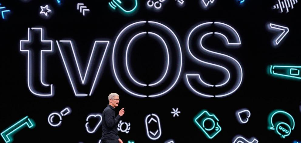 Apple CEO Tim Cook says its AppleTV operating system will work with Microsoft Xbox and Sony Corp PlayStation video game controllers. Photo: Reuters