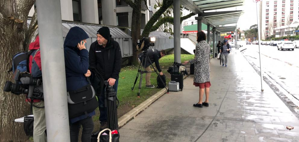 Media from different news agencies covering the birth of the Prime Minister's baby gather outside Auckland Hospital. Photo: Debbie Porteous