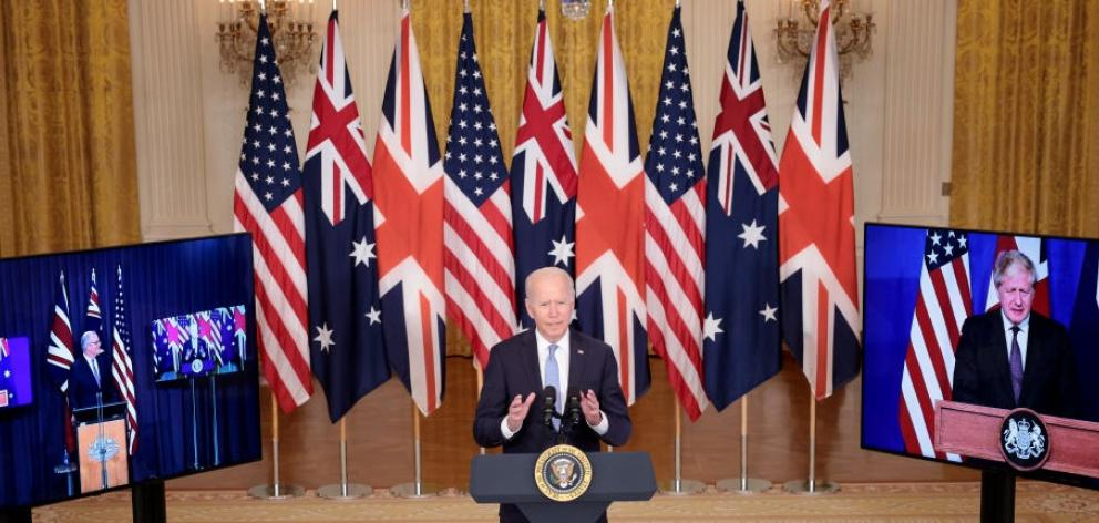From left: Scott Morrison, Joe Biden and Boris Johnson made the virtual announcement from each of...