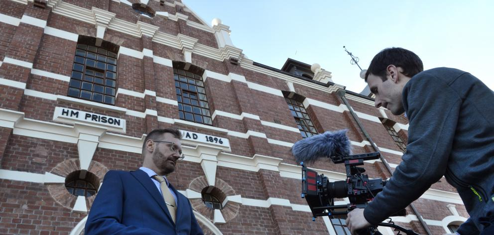 Abacus Multimedia producer Paul Dobson (left), of Sydney, is filmed by freelance cinematographer Luke Bremner, of Dunedin, outside the old Dunedin Prison in July last year. Photo: File