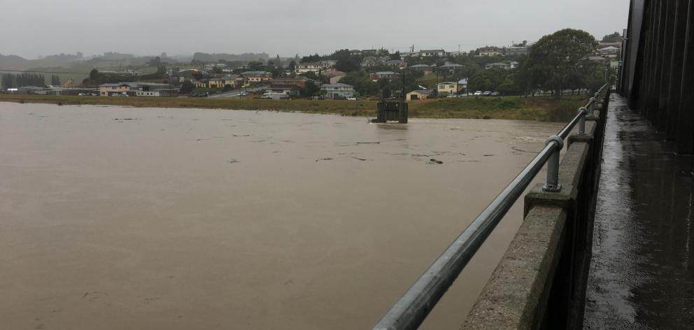 The Clutha River at Balclutha Bridge, about 9.10am, just having passed its second flood warning of 1680 cumecs. Photo: Richard Davison