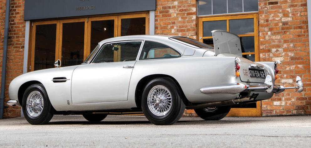 An original Aston Martin DB5 car, one of just three surviving examples, fitted with James Bond...