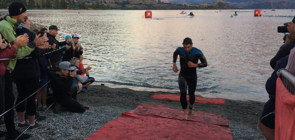 Christchurch triathlete Dylan McNeice leads the field out of Lake Wanaka at the end of the swim...
