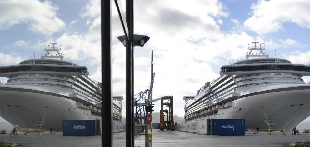 Golden Princess, the last vessel of the cruise ship season, mirrored in a window at Port Otago....