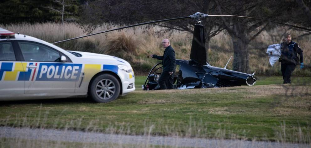 Police at the scene of the crash that injured four people including the bride and groom on their...