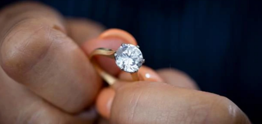 "The ring that had been appraised in 2012 as a 9.3mm diamond solitaire of ""very good"" cut, on a..."