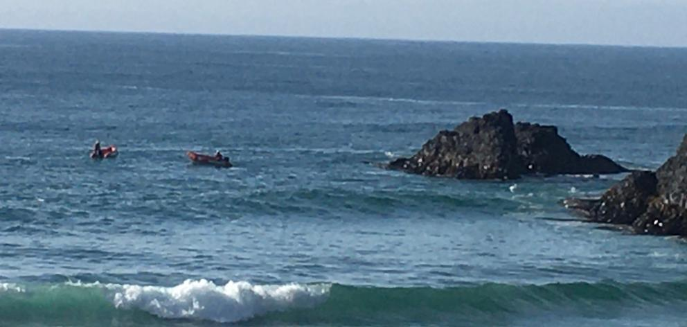 Surf life savers in IRBs continue their search this morning. Photo: Stephen Jaquiery